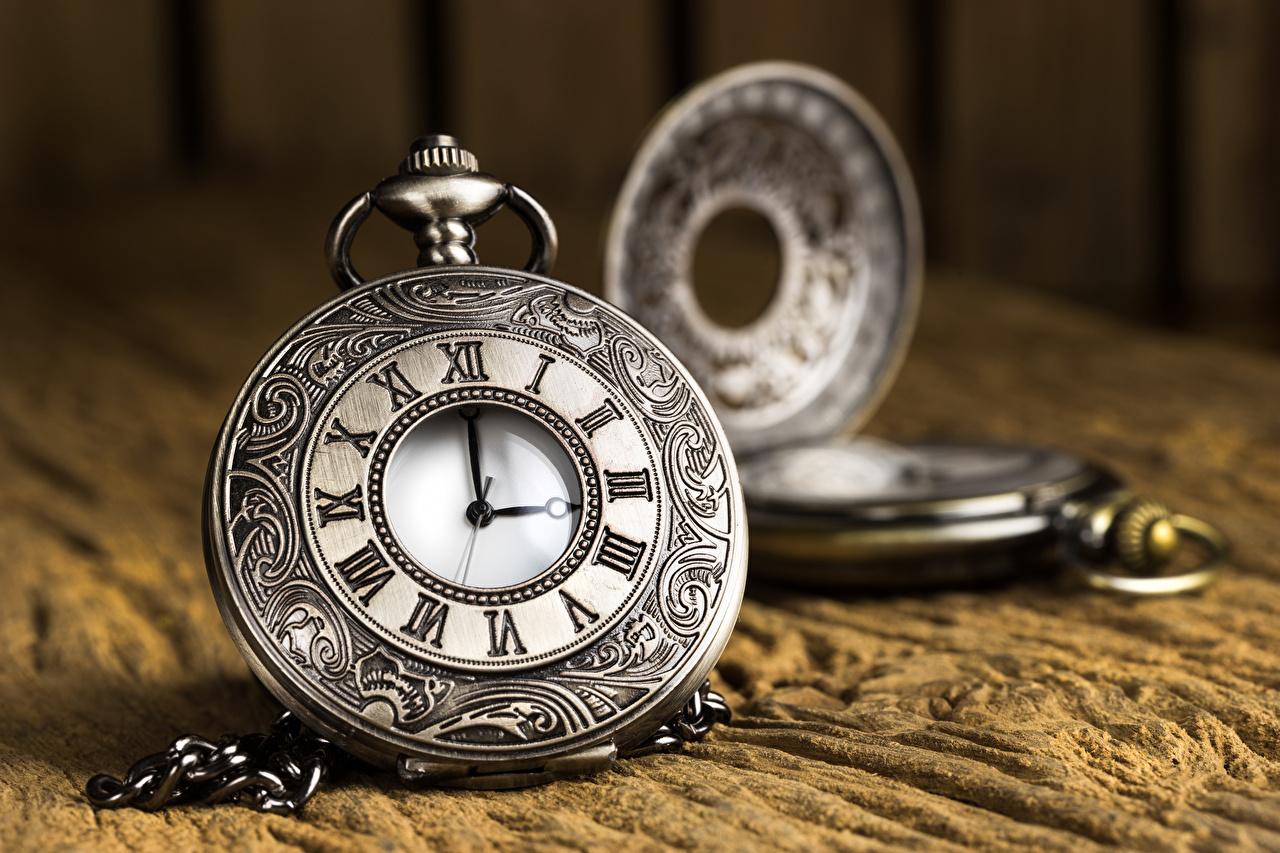 Fotos von Taschenuhr Uhr hautnah Nahaufnahme Großansicht