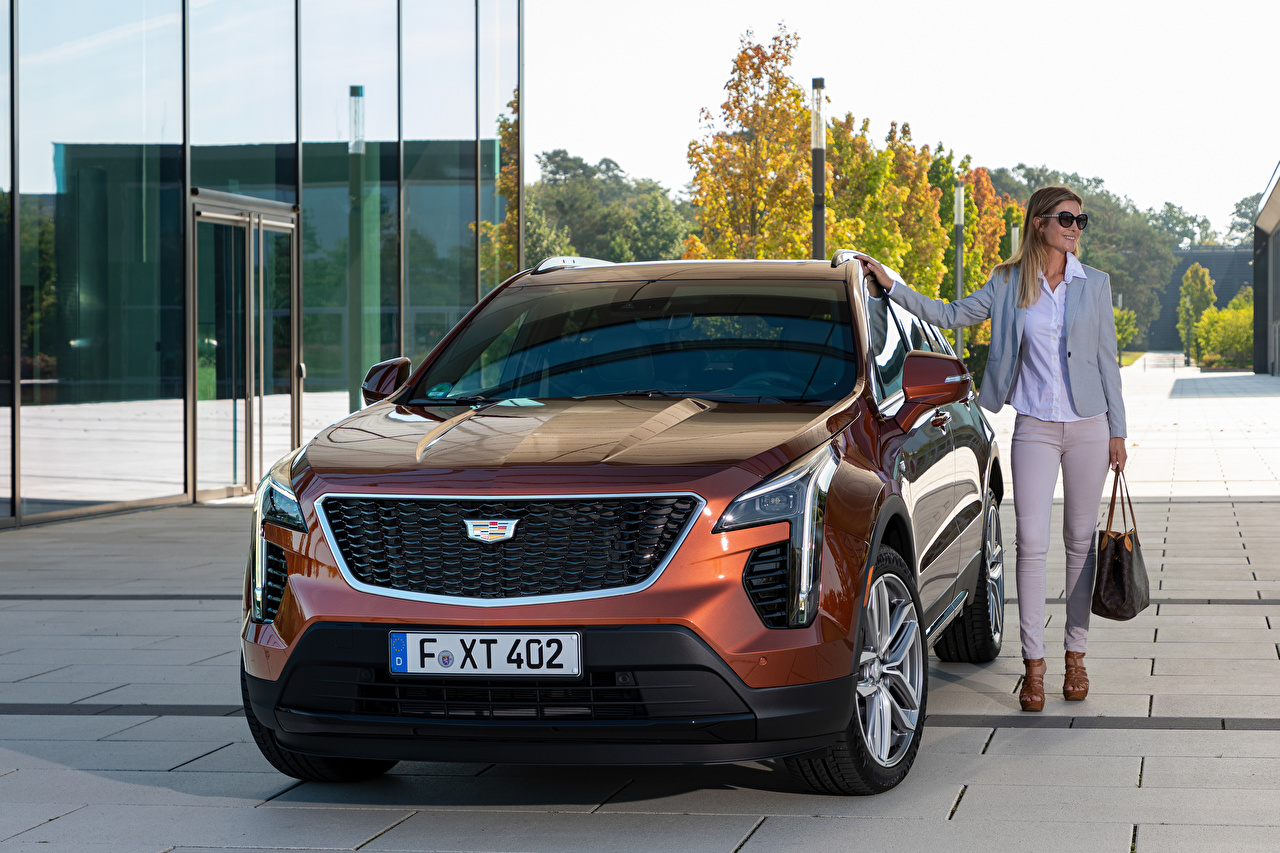 Image Cadillac CUV XT4 350D, Launch Edition Sport, 2020 young woman Cars Front Metallic Crossover Girls female auto automobile
