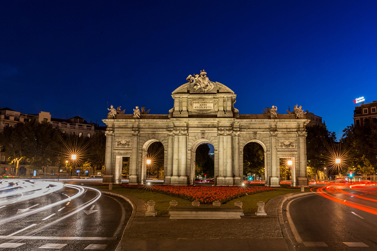 Pictures Madrid Spain Arch Town square Puerta de Alcala Roads night time Cities Sculptures Night