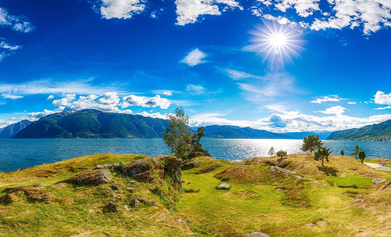Fotos Island Natur Sonne Himmel Landschaftsfotografie Gras Küste Flusse Wolke