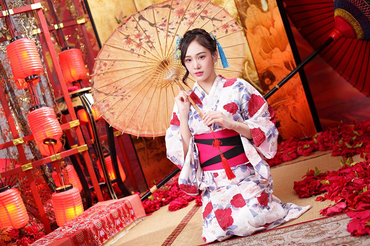 Images Kimono Girls Petals Asian Sitting Umbrella female young woman Asiatic sit parasol
