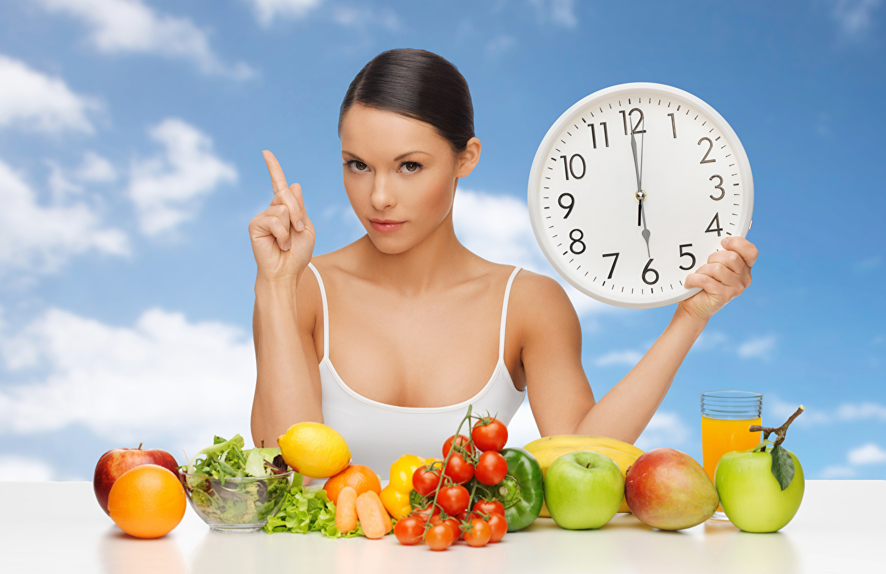 Desktop Wallpapers Brown haired Clock Juice Tomatoes young woman Apples Fruit Vegetables Girls female