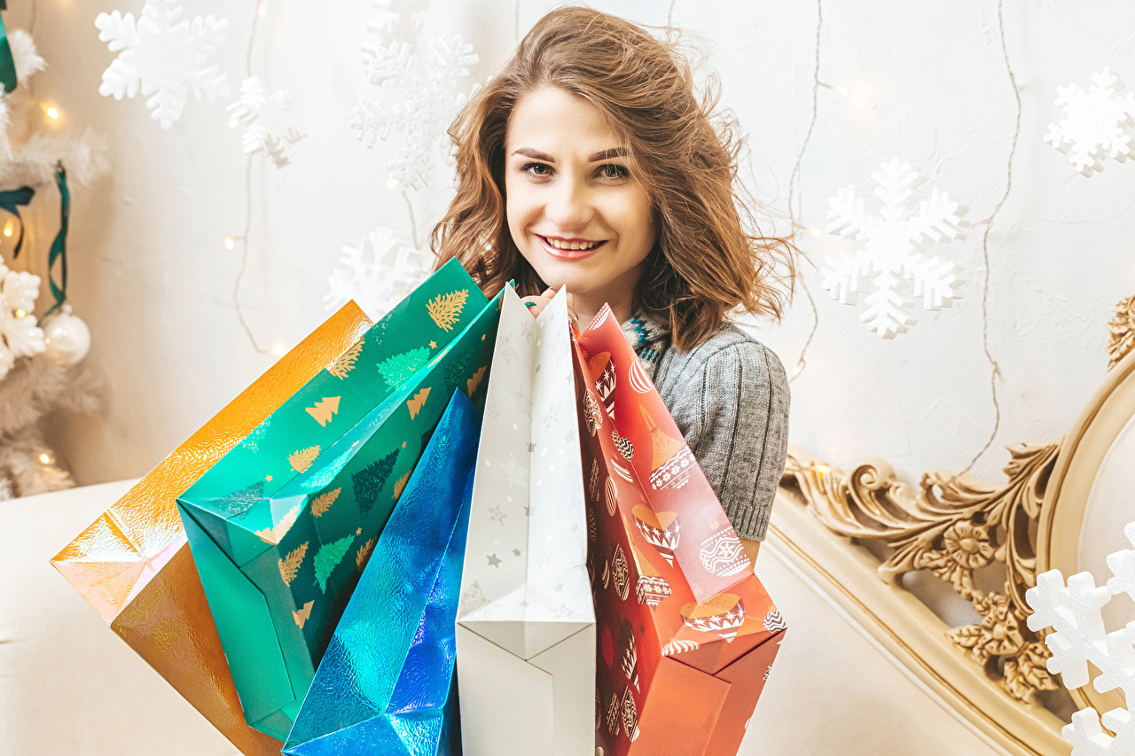 Photos Christmas Brown haired Smile Girls Gifts Glance New year female young woman present Staring