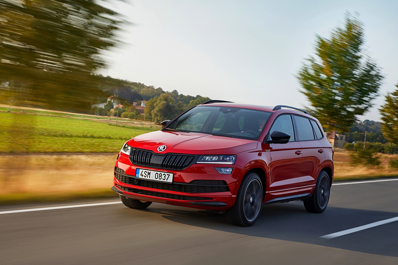 Desktop Wallpapers Skoda 2018 Karoq Sportline Red moving Cars Motion riding driving at speed auto automobile