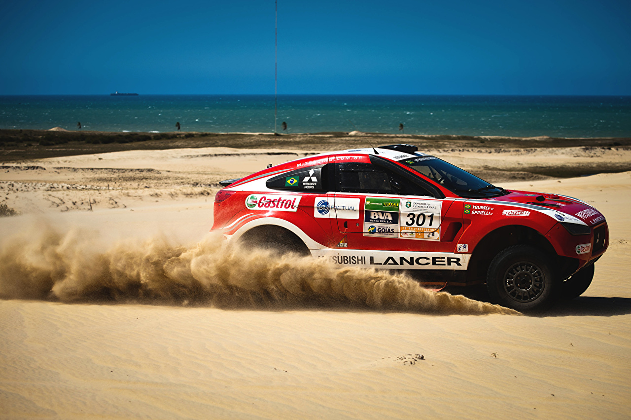 Pictures Mitsubishi lancer Beach Red athletic Sand Side Cars beaches Sport sports auto automobile