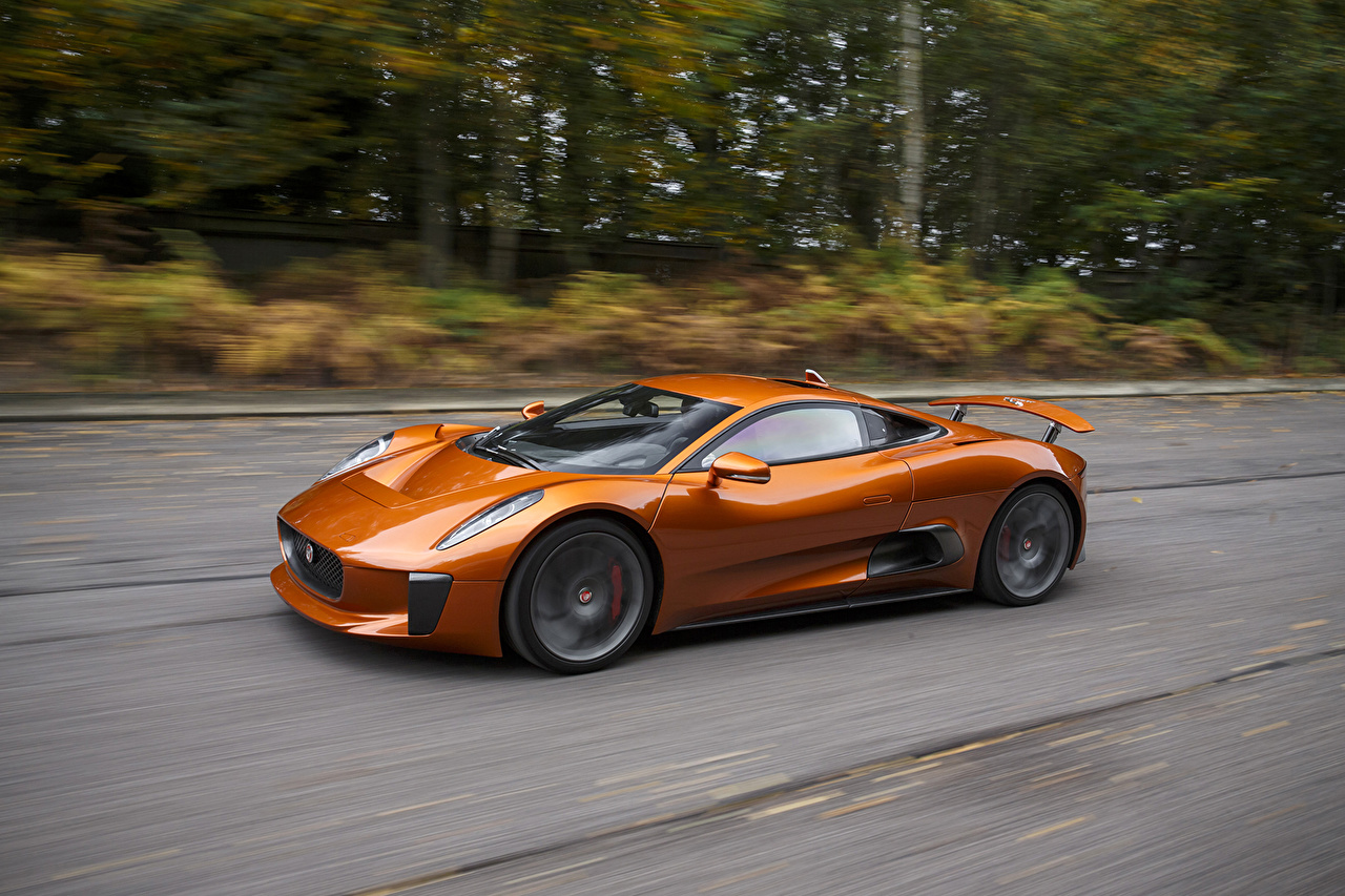 Photo Jaguar 2015 C-X75 Spectre concept expensive Orange Motion Metallic automobile Luxury luxurious moving riding driving at speed Cars auto