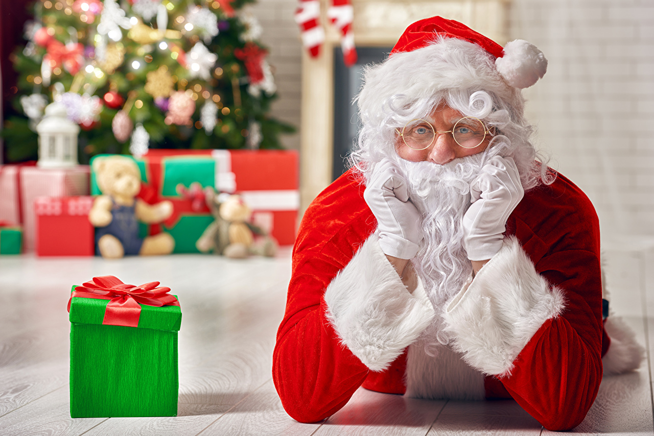 Pictures New year Glove Santa Claus present Glasses Staring Christmas Gifts eyeglasses Glance