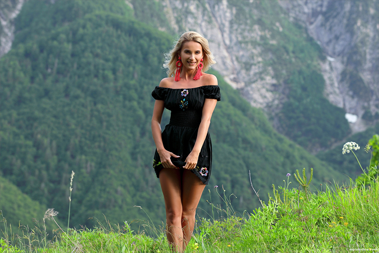 Images Cara Mell Blonde girl female mountain Legs Grass Staring Dress Girls Mountains young woman Glance gown frock