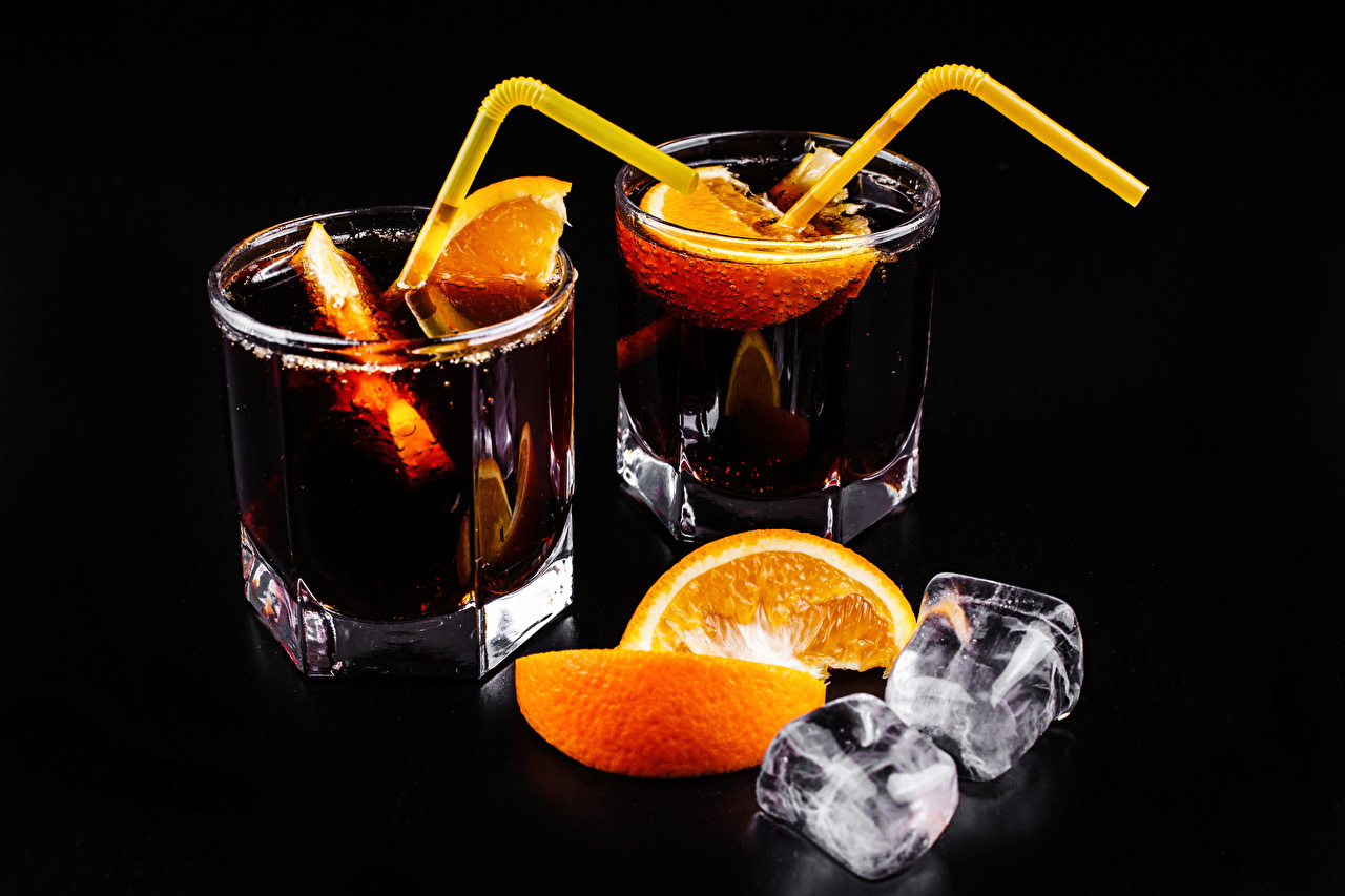 Image Alcoholic drink Ice Two Orange fruit Highball glass Food Mixed drink Black background 2 Cocktail