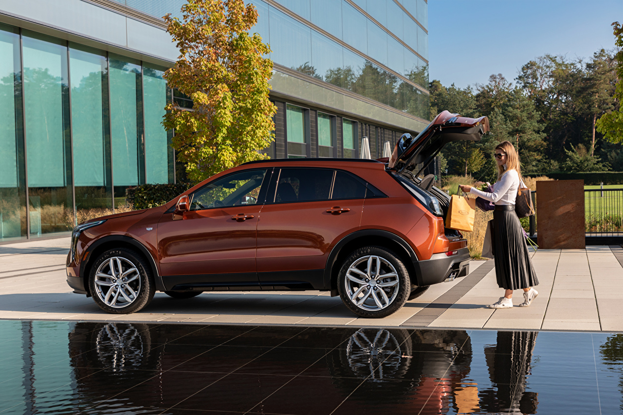 Wallpaper Cadillac Crossover Opened door XT4 350D, Launch Edition Sport, 2020 Girls Side Metallic automobile CUV female young woman Cars auto