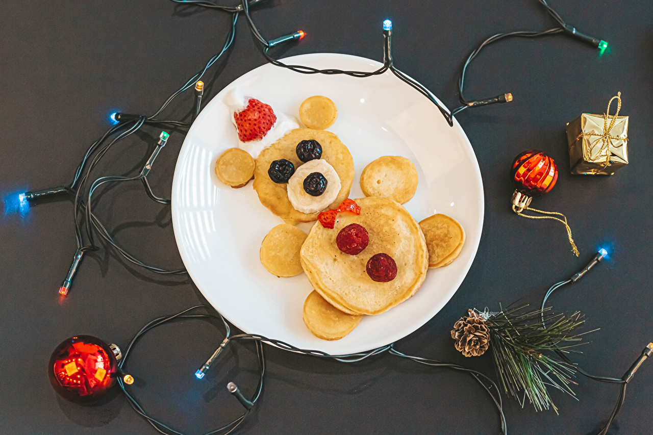 Pictures New year Pancake Teddy bear Food Berry Plate Fairy lights Conifer cone Gray background Christmas hotcake Pine cone