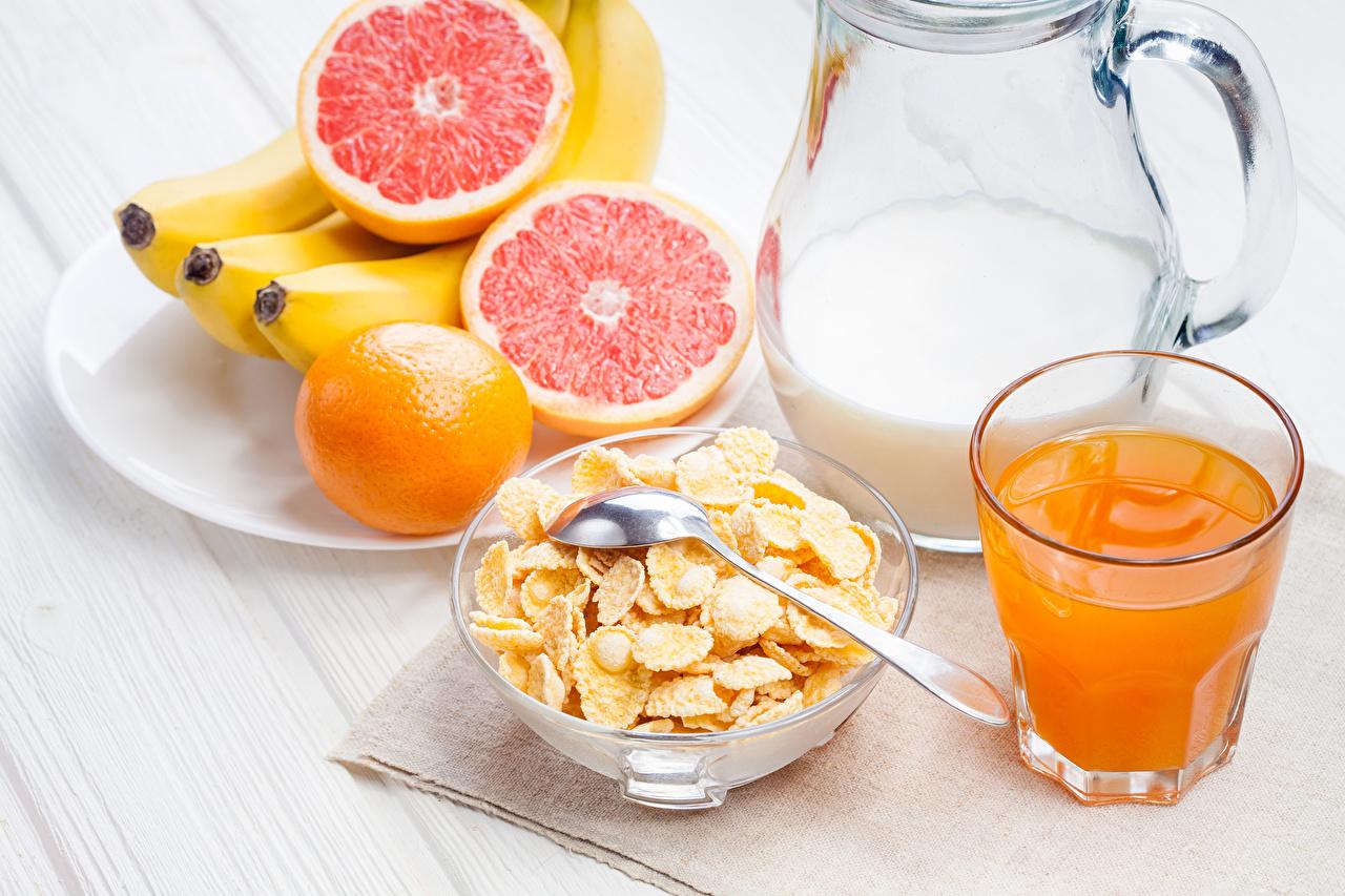 Photos Corn flakes Juice Breakfast Grapefruit Bananas pitcher Highball glass Food jugs Jug container