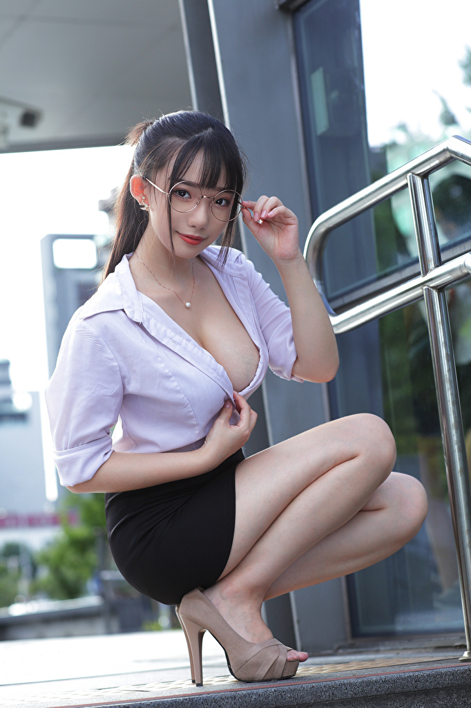 Images Skirt Brunette girl Décolletage Blouse Girls Asian sit Glasses Staring  for Mobile phone neckline decollete female young woman Asiatic Sitting eyeglasses Glance
