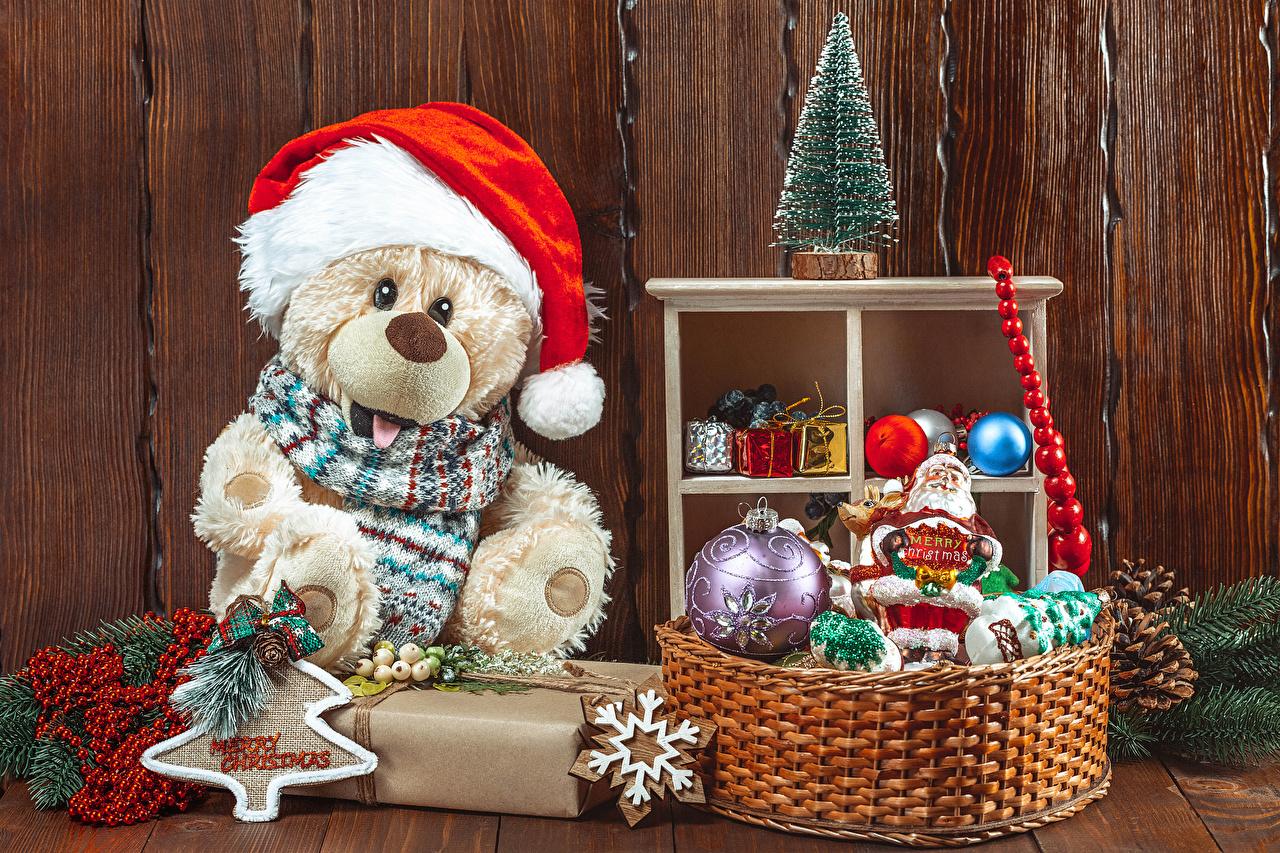 Fotos von Neujahr Mütze Schneeflocken Weihnachtsbaum Weidenkorb Knuddelbär Kugeln Christbaum Tannenbaum Teddy Teddybär