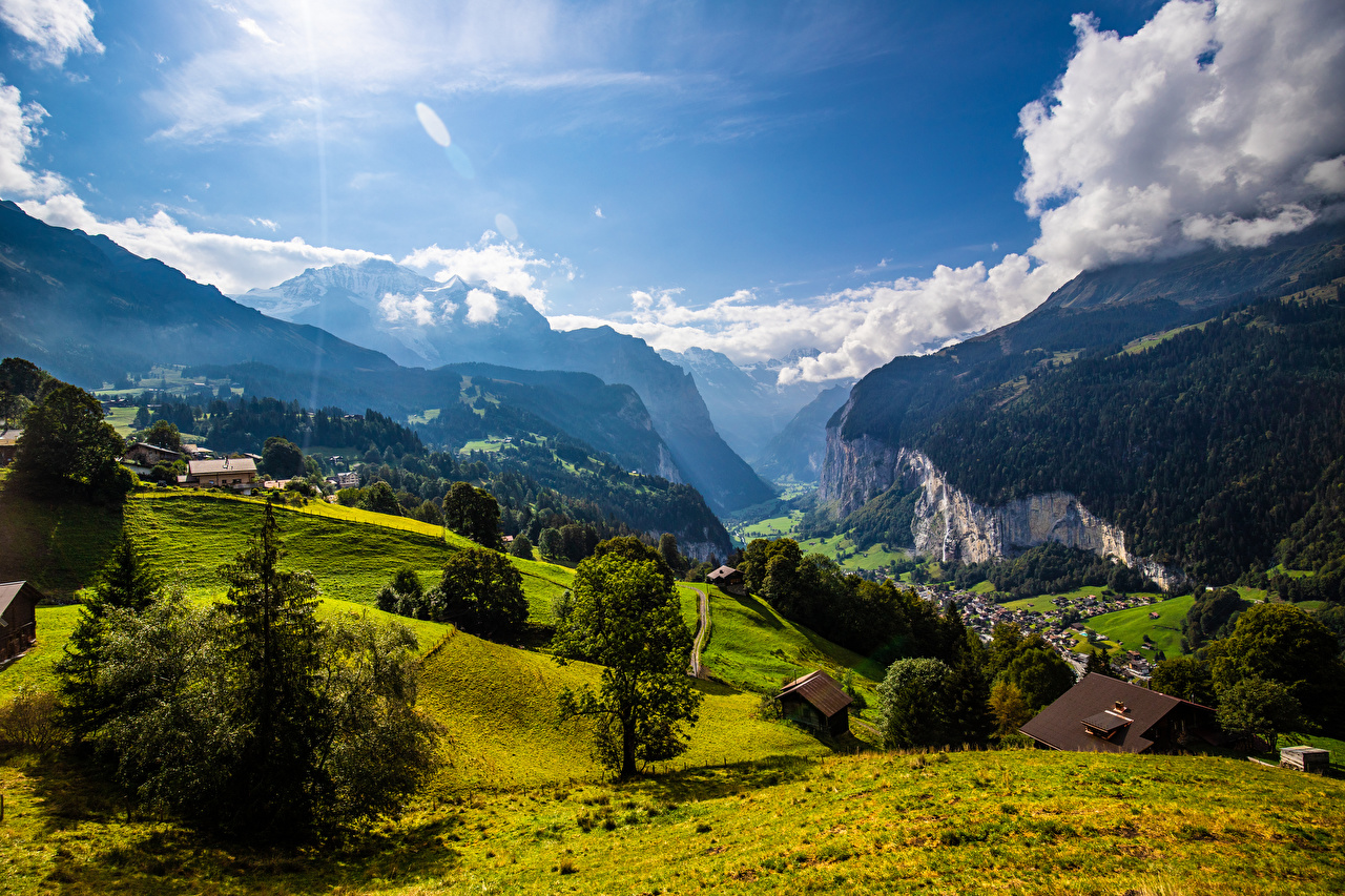 Pictures Alps Switzerland Eiger Crag Girls mountain landscape photography Clouds Rock Cliff female Mountains young woman Scenery