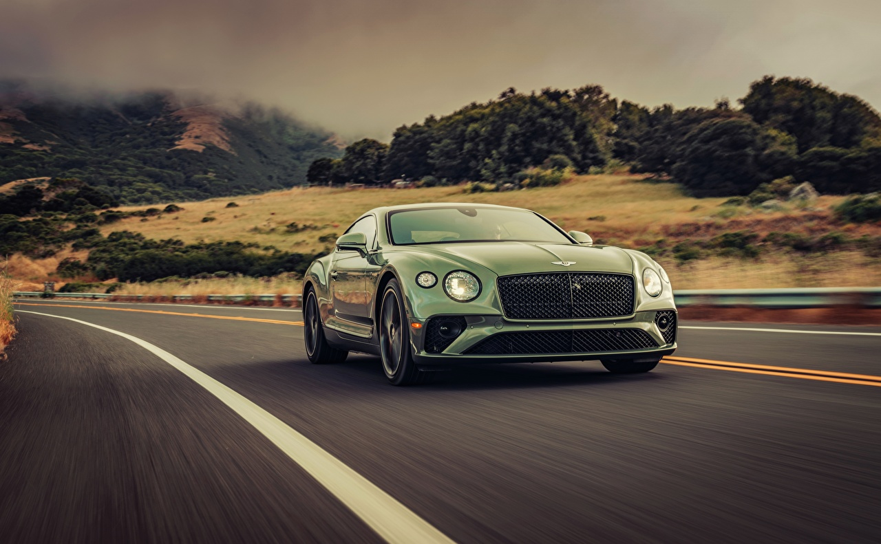 Photo Bentley 2019 Continental GT V8 Green riding auto moving Motion driving at speed Cars automobile
