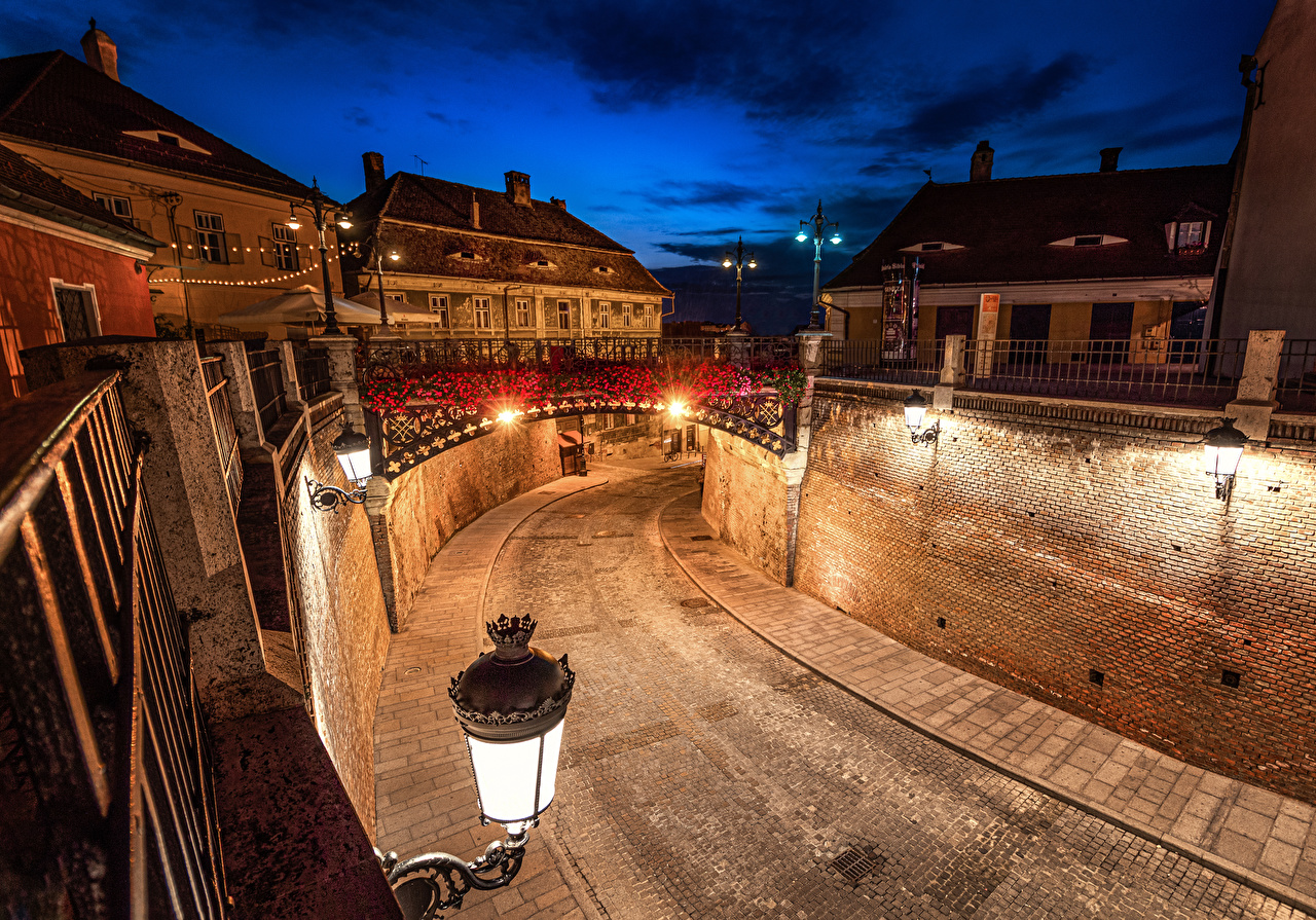 Picture Romania Sibiu bridge Roads Wall night time Street lights Houses Cities Bridges Night walls Building