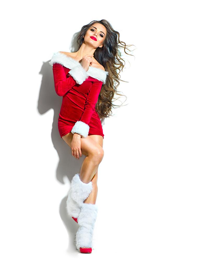 Fotos Neujahr Braunhaarige Stiefel junge frau Uniform Weißer hintergrund Braune Haare Mädchens junge Frauen