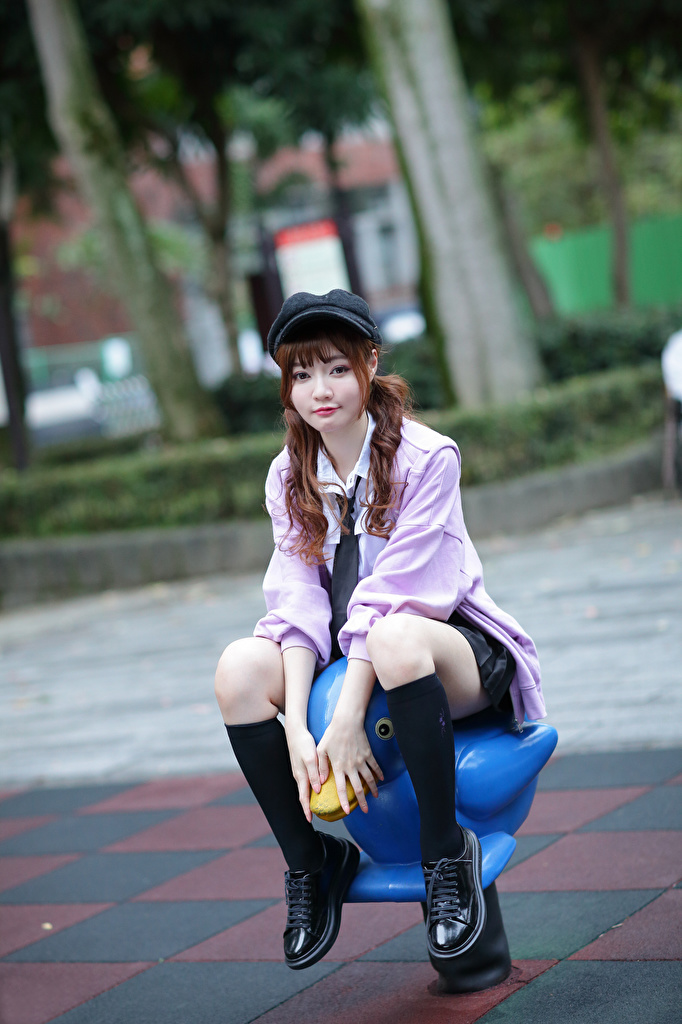 Pictures blurred background Girls Legs Asiatic sit Glance Baseball cap  for Mobile phone Bokeh female young woman Asian Sitting Staring