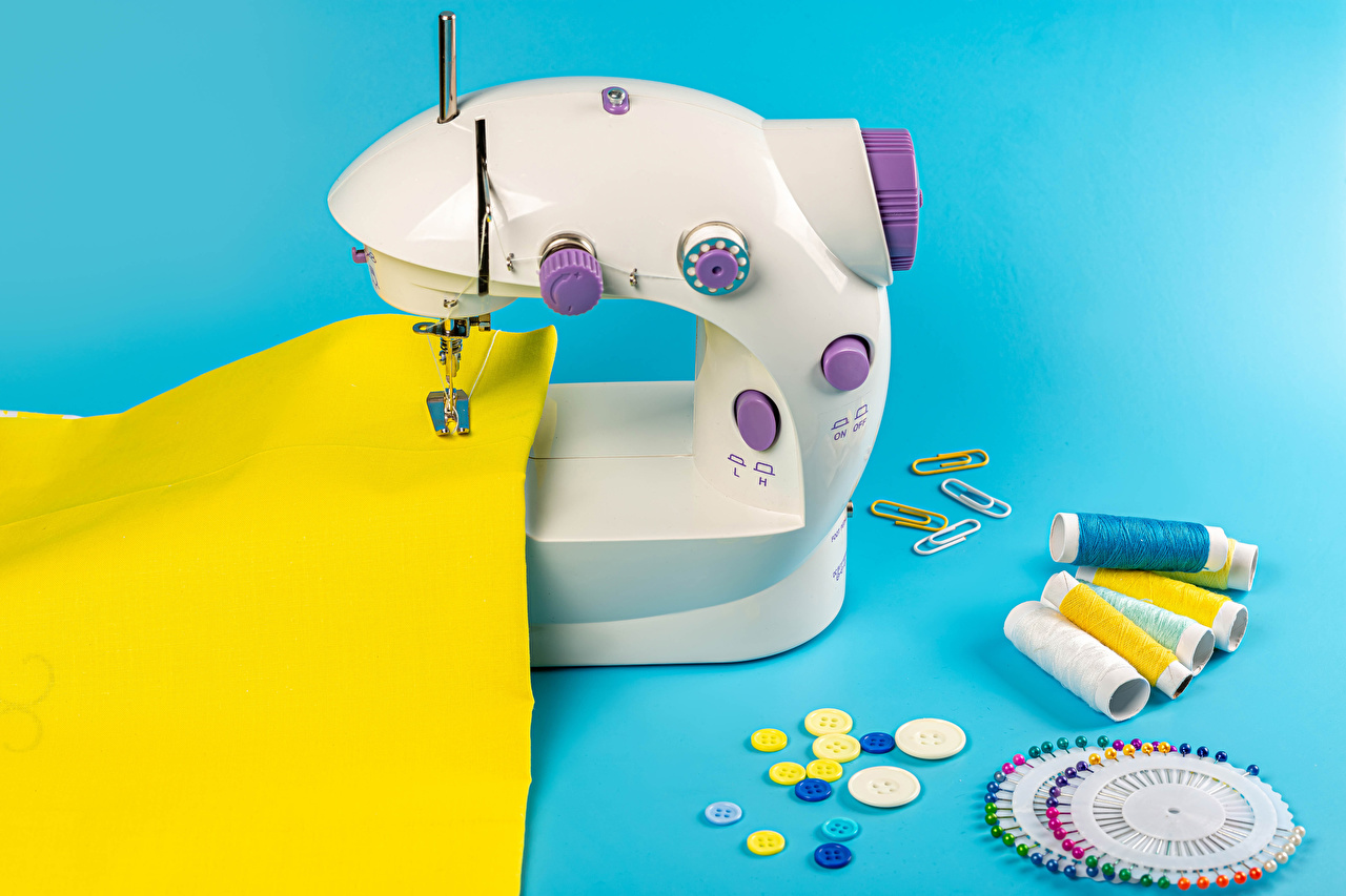 Pictures Woven fabric Threads Sewing machine Colored background Cloth