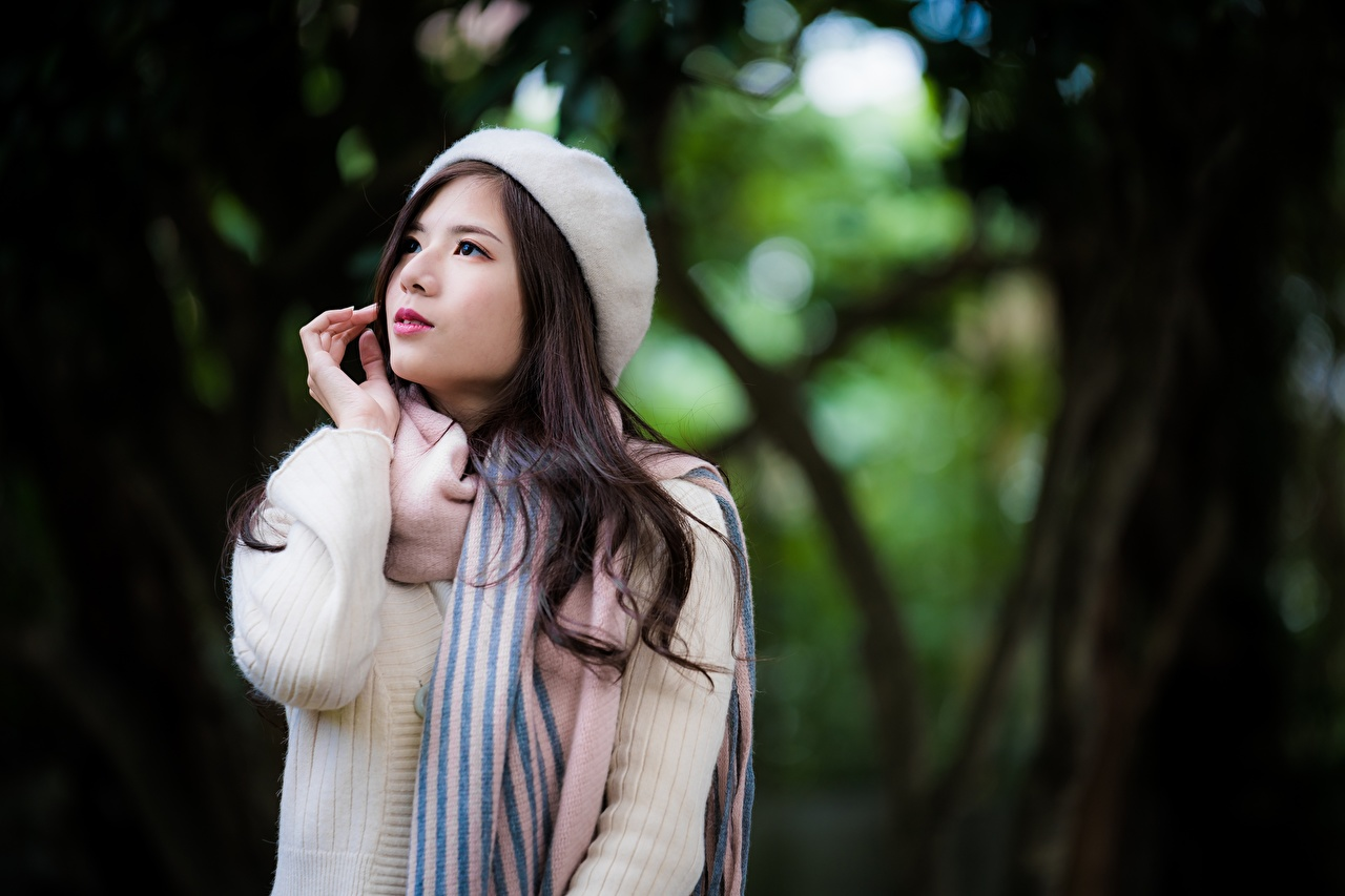 Picture Brunette girl Scarf blurred background young woman Asian Sweater Hands Bokeh Girls female Asiatic