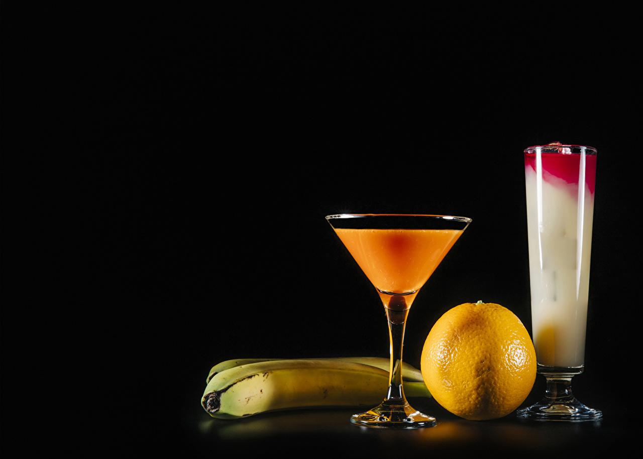 Picture Orange fruit Bananas Highball glass Food Cocktail Stemware Black background Mixed drink