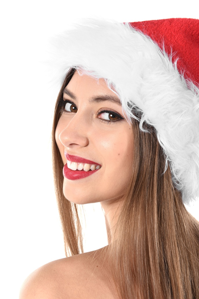 Images Christmas Brown haired Smile Girls Winter hat Teeth Glance White background New year young woman Staring