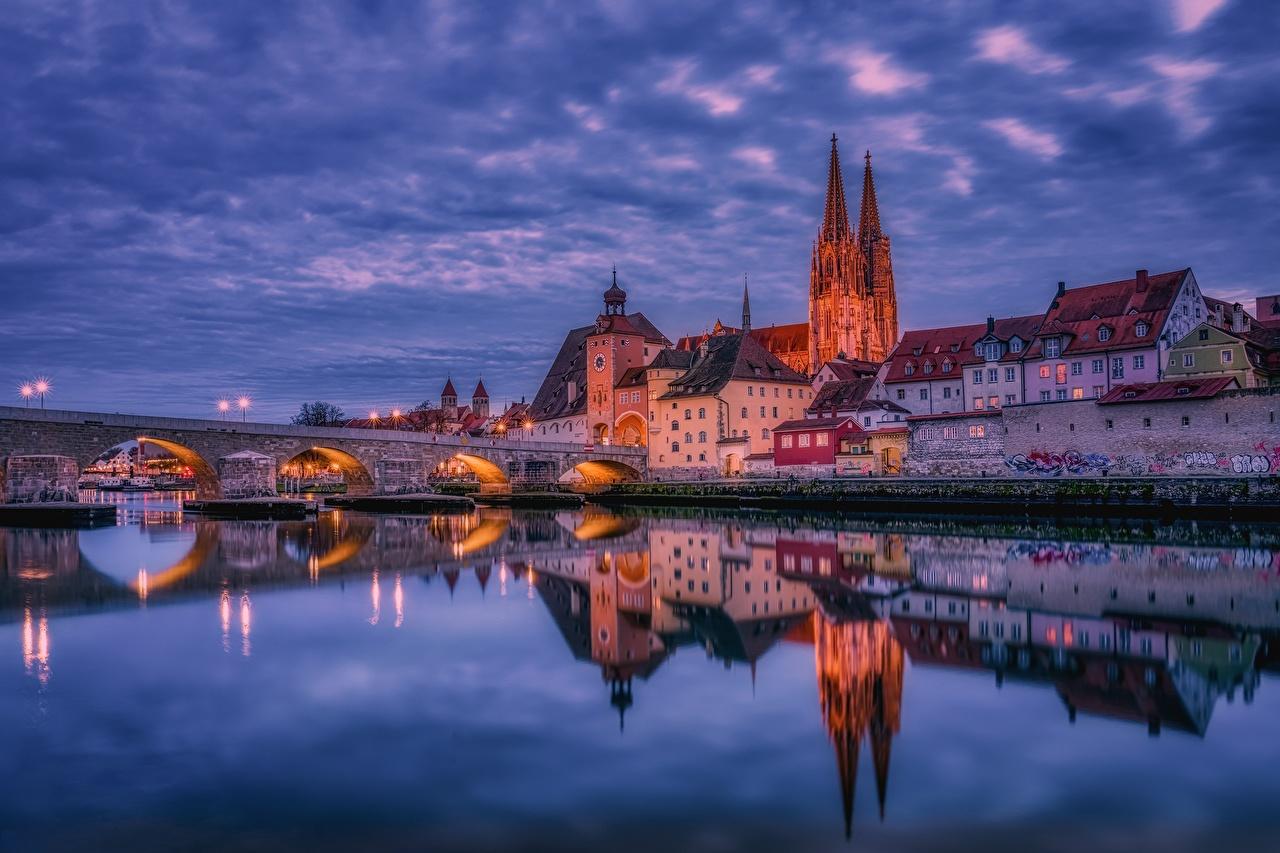 Picture Germany Regensburg bridge Reflection Rivers Evening Houses Cities Bridges reflected river Building