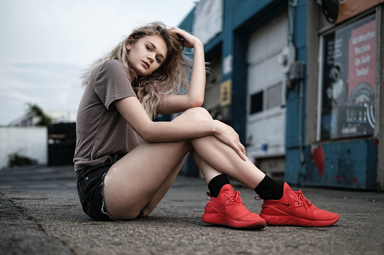 Images Jewel T-shirt trainers young woman Legs Shorts Sitting Glance Girls female sneakers Athletic shoe sit Staring