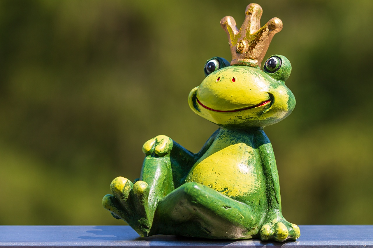 Images Frogs Crown blurred background Sitting Toys Animals frog Bokeh sit toy animal