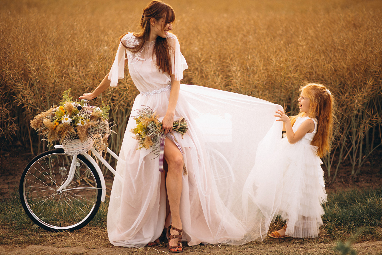 Image Little girls brides Brown haired Joy bike Bouquets Children Girls gown Bride happy joyful child bouquet Bicycle bicycles female young woman frock Dress