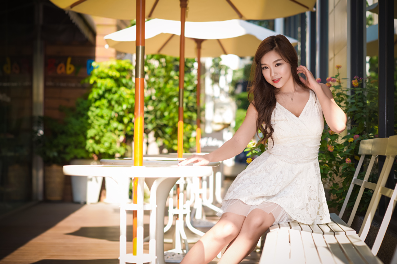 Wallpaper Brown haired Girls Asian sit Bench Hands frock female young woman Asiatic Sitting gown Dress