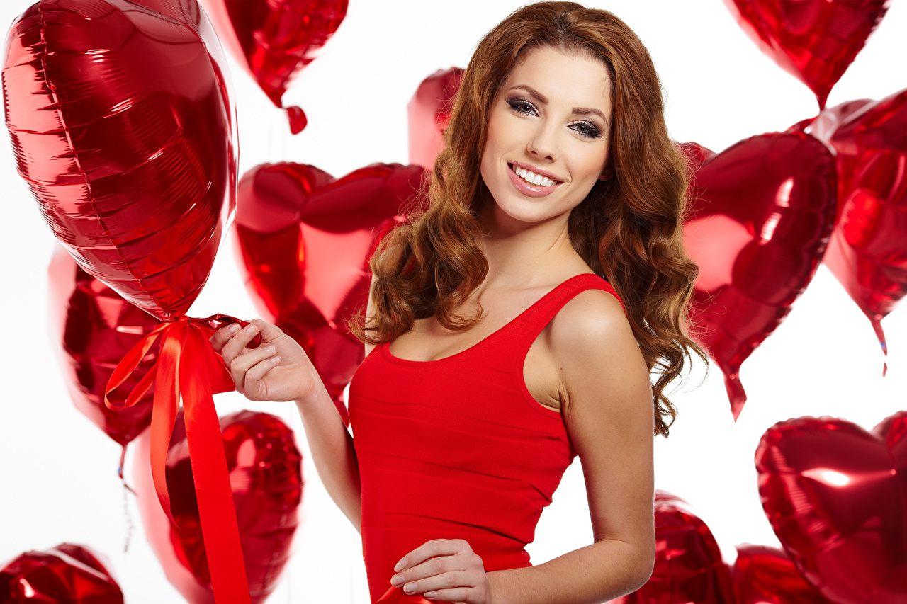 Photos Valentine's Day Brown haired Smile Heart Toy balloon Girls Staring balloons female young woman Glance