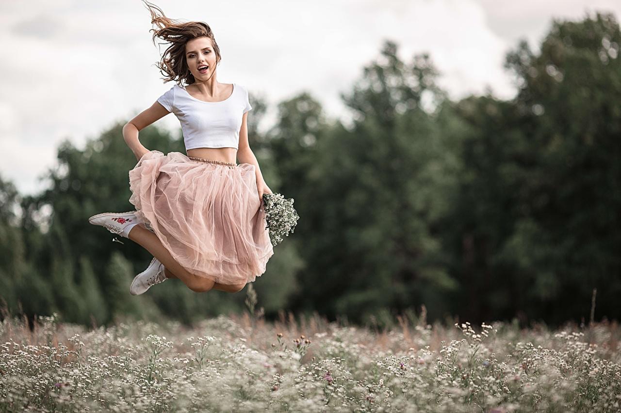 Foto Rock Bokeh junge frau Sprung unscharfer Hintergrund Mädchens junge Frauen