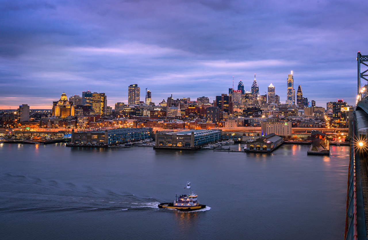Pictures Rays of light USA Philadelphia Pier Rivers Evening speedboat Houses Cities river Berth Marinas Motorboat powerboat Building