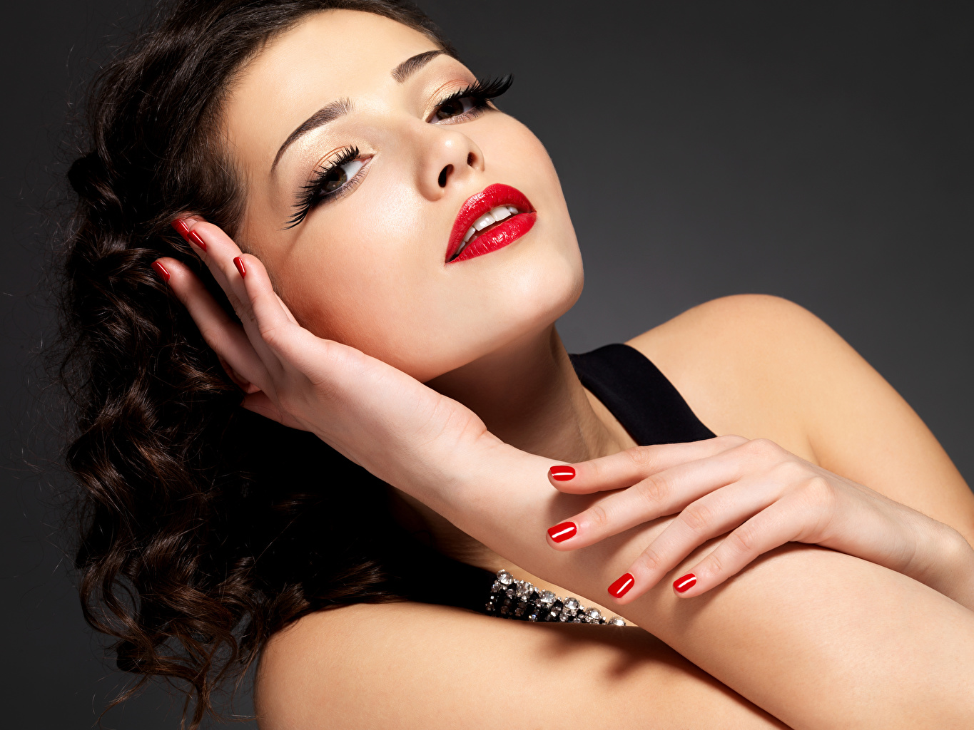 Picture Brunette girl Manicure Makeup Girls Hands Glance Red lips Gray background female young woman Staring