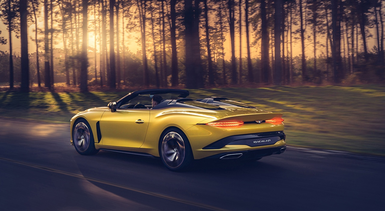 Image Bentley Mulliner Bacalar Luxury Roadster Yellow at speed Cars Metallic luxurious expensive moving riding Motion driving auto automobile