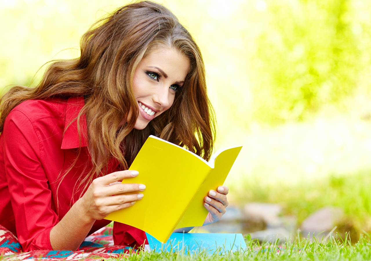 Image Girls Izabela Magier Brown haired Glance Smile Grass Book female young woman Staring books