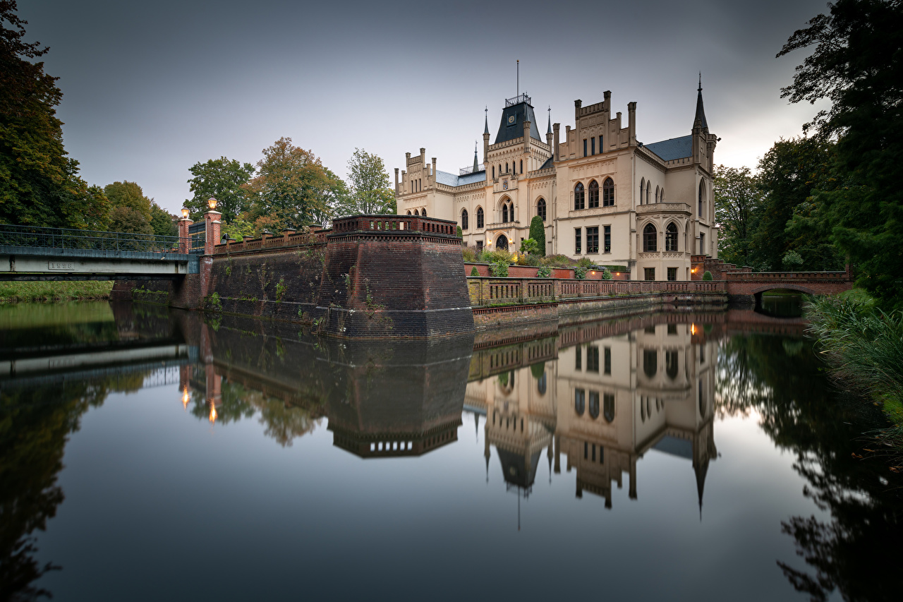 Desktop Wallpapers Germany towers Evenburg Castle castle Nature Pond Reflection Tower Castles reflected