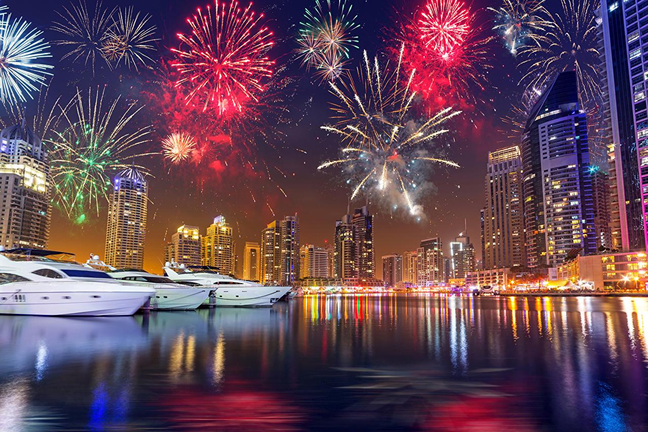 Images Dubai New year Fireworks Emirates UAE Marinas night time Skyscrapers Cities Christmas Pier Berth Night