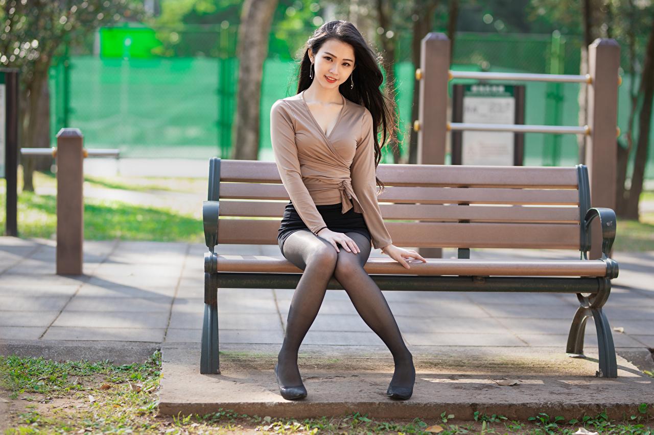 Desktop Wallpapers Skirt Brunette girl Blouse Girls Legs Asian sit Bench Staring female young woman Asiatic Sitting Glance