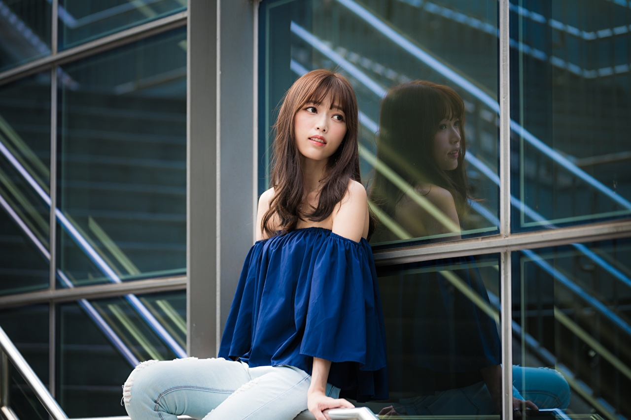 Images Brown haired blurred background Girls Asian sit Glance Bokeh female young woman Asiatic Sitting Staring
