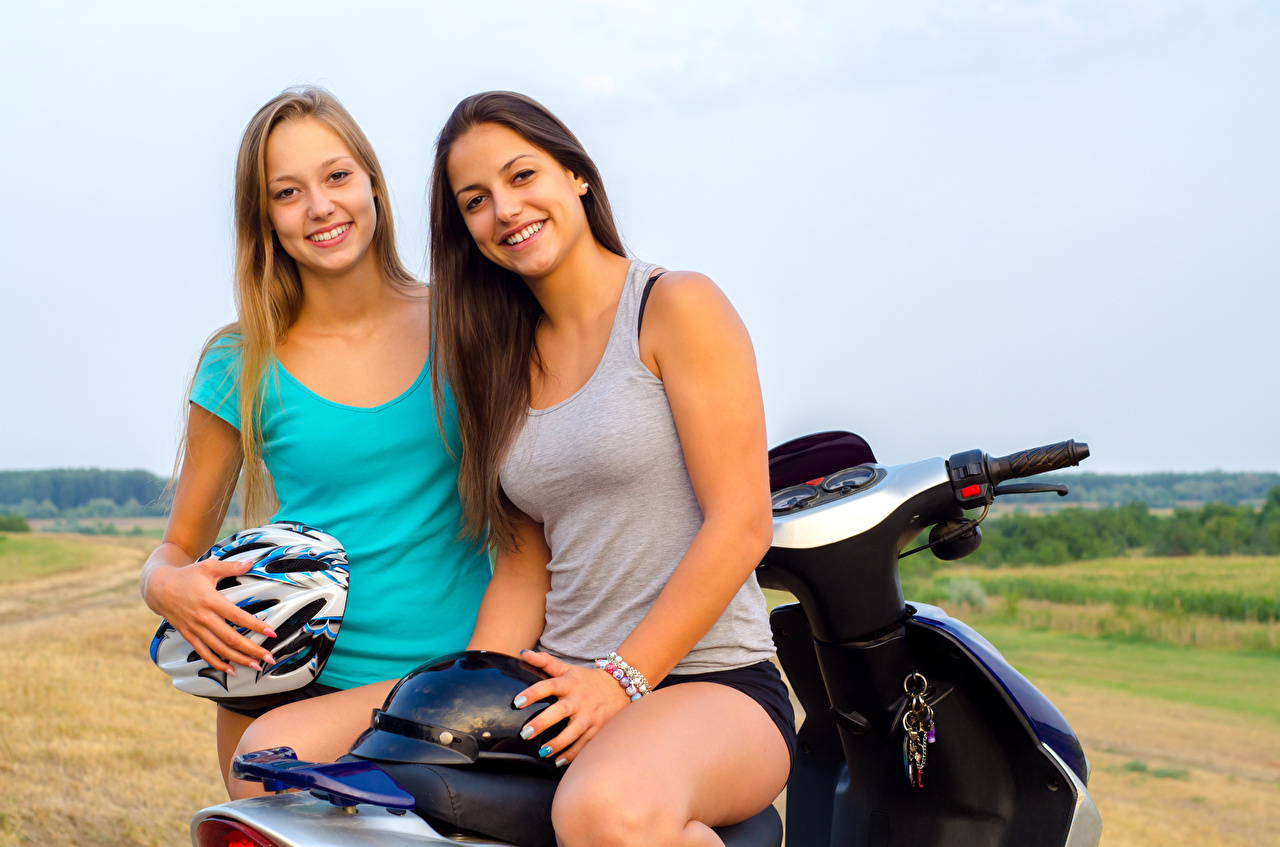 Picture Helmet Smile Two young woman Singlet Motorcyclist 2 Girls female Sleeveless shirt