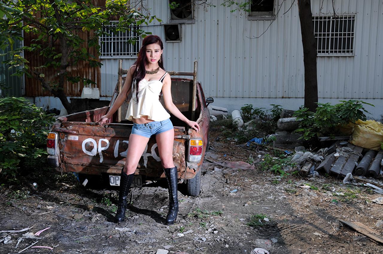 Wallpaper Wearing boots Pose Girls Legs Asian Singlet Shorts Glance posing female young woman Asiatic Sleeveless shirt Staring