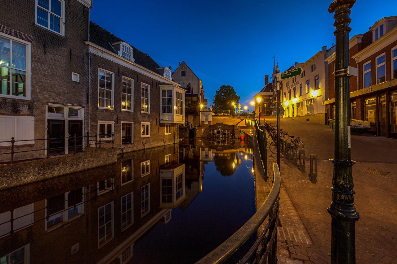 Picture Netherlands Maassluis Canal Evening Street lights Houses Cities Building