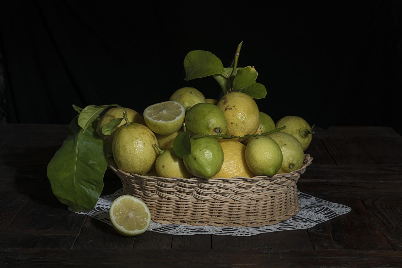 Bilder von Zitronen Weidenkorb Lebensmittel Viel Schwarzer Hintergrund Zitrone das Essen