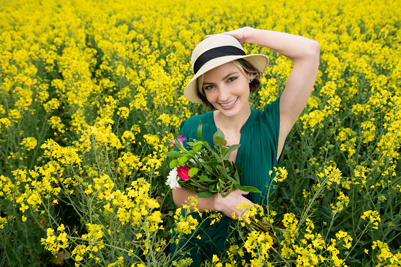 Pictures Smile Alena bouquet Hat Girls oilseed rape Fields Glance Bouquets female Rapeseed young woman Staring
