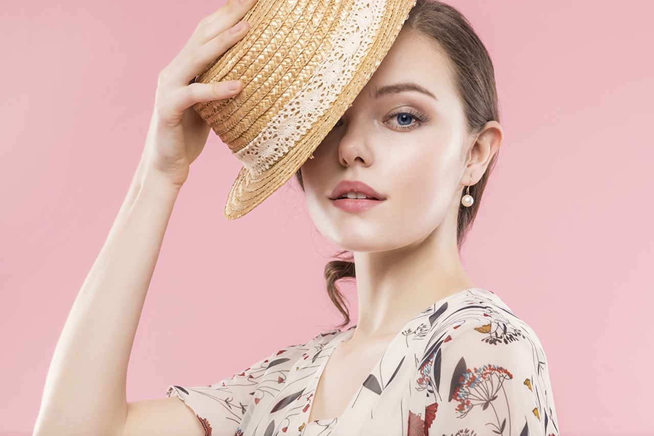 Images Brown haired Hat female Hands Pink background Staring Girls young woman Glance