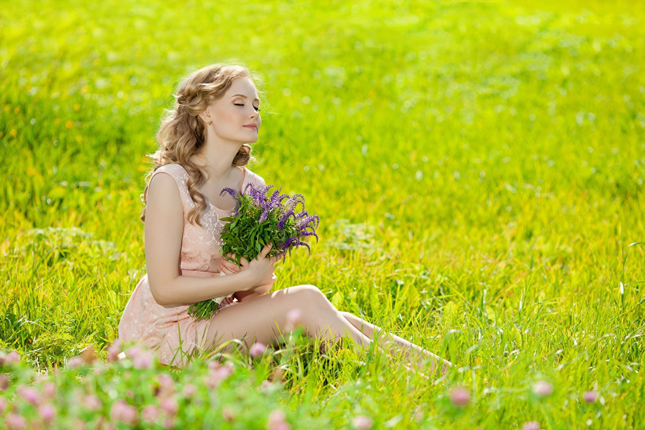 Photos Blonde girl blurred background Bouquets Summer female Grass Sitting Bokeh bouquet Girls young woman sit