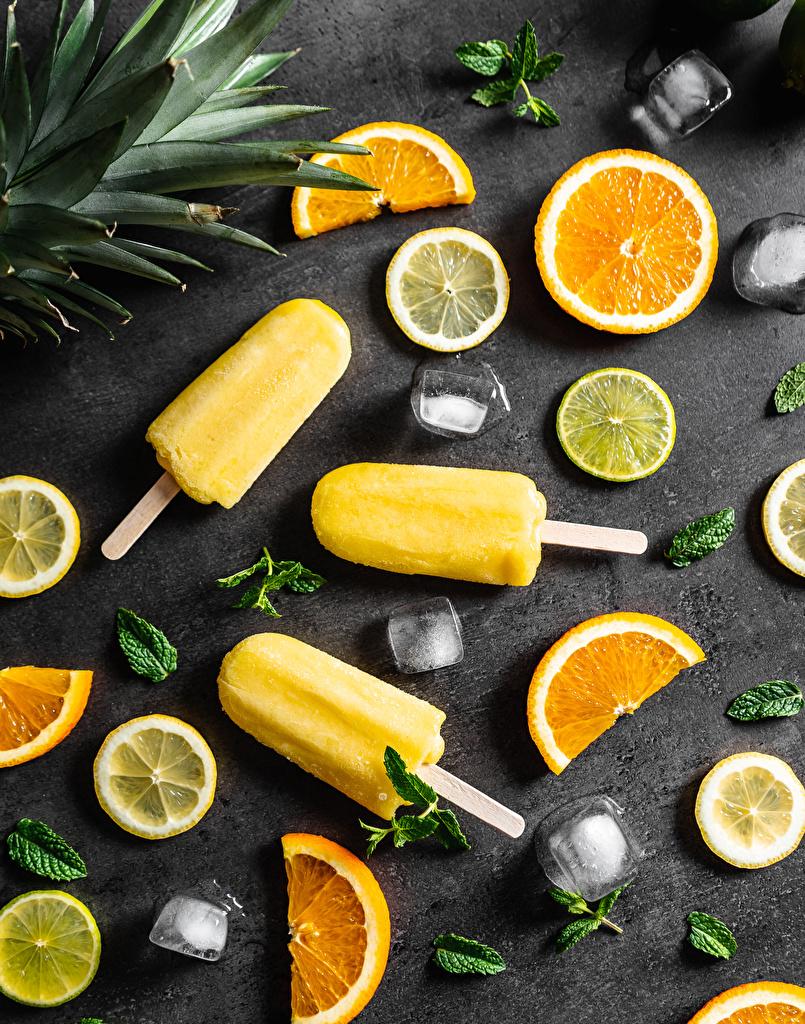 Fotos von Apfelsine Speiseeis stücke Zitronen das Essen Geschnitten  für Handy Orange Frucht Stück Zitrone Lebensmittel geschnittene geschnittenes